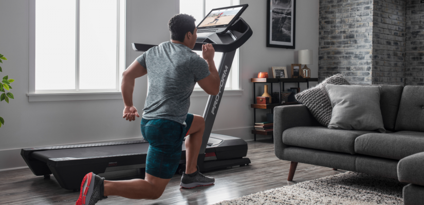 Man doing a HIIT workout using a iFit-connected treadmill