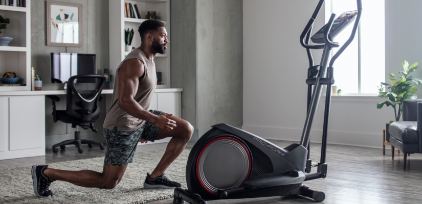 Man using an iFit-connected elliptical during a Tabata workout