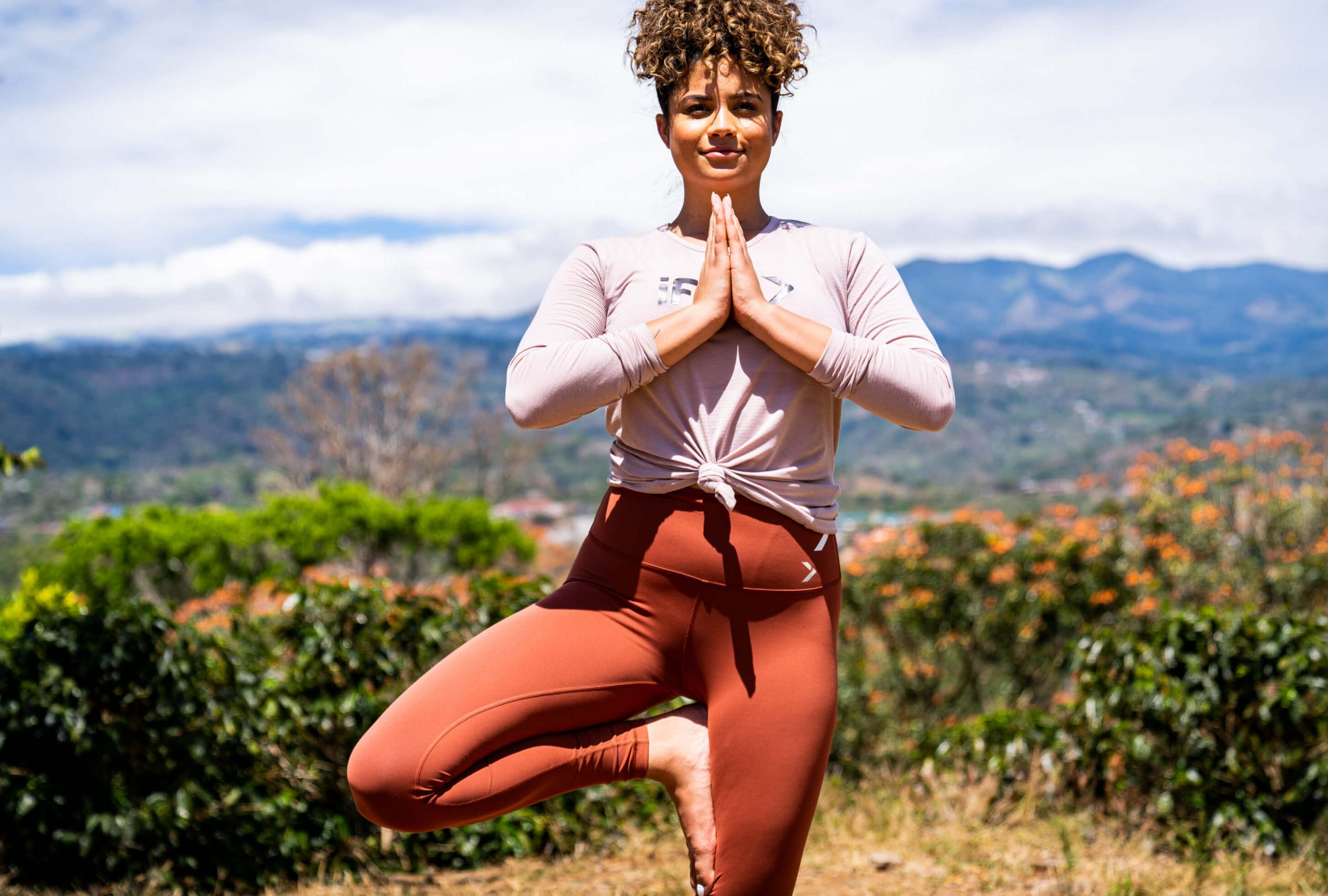 iFIT Trainer Thalia Ayres Randolph coaches a yoga workout