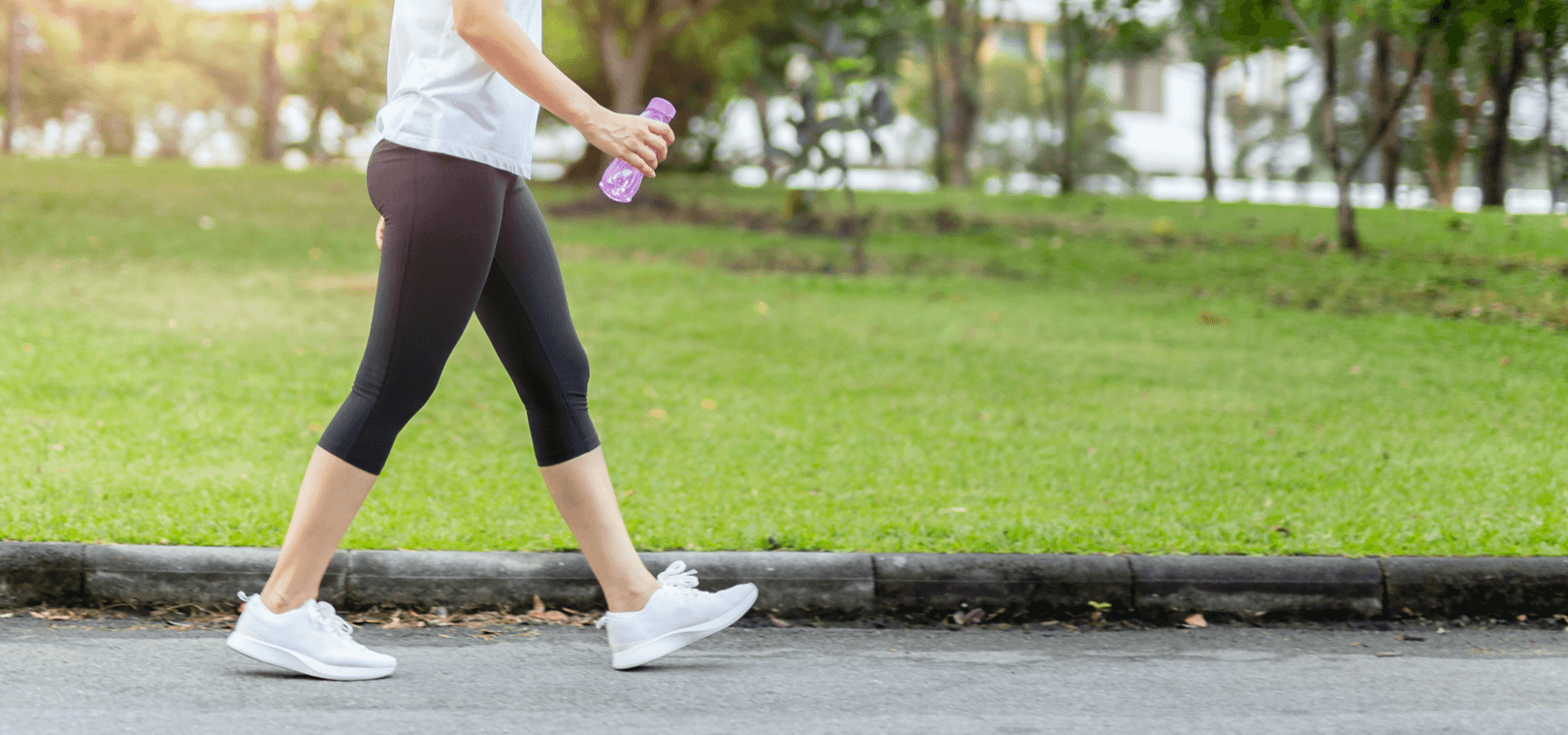 Woman completes an iFit walking workout