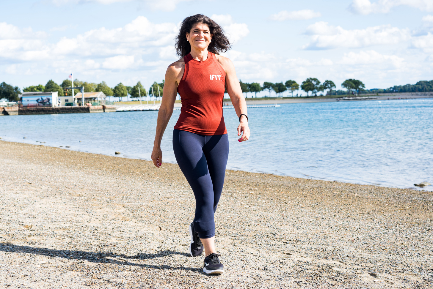 iFIT Guide Dr. Eva Selhub coaches a walking workout on the beach