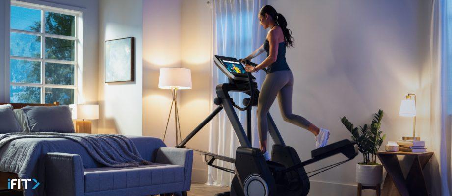 Woman takes an iFIT elliptical workout