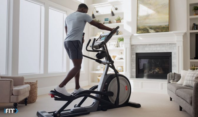 Man takes an iFIT elliptical class
