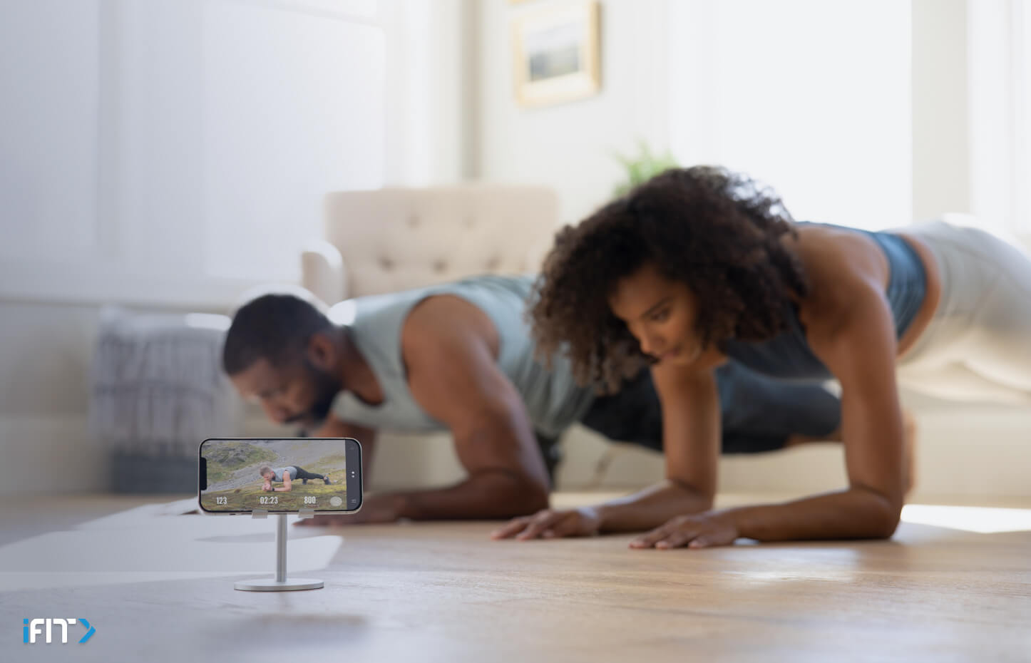 Couple does planks during a bodyweight workout