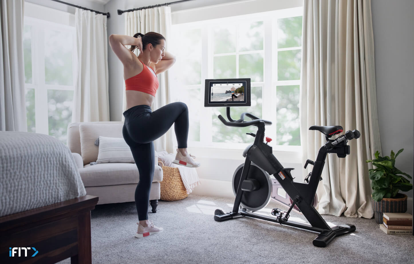 Woman completes an iFIT HIIT class