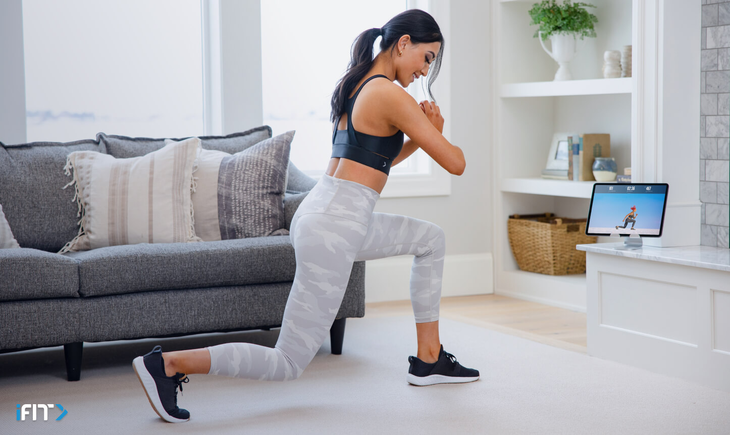 Woman completes iFIT bodyweight exercises