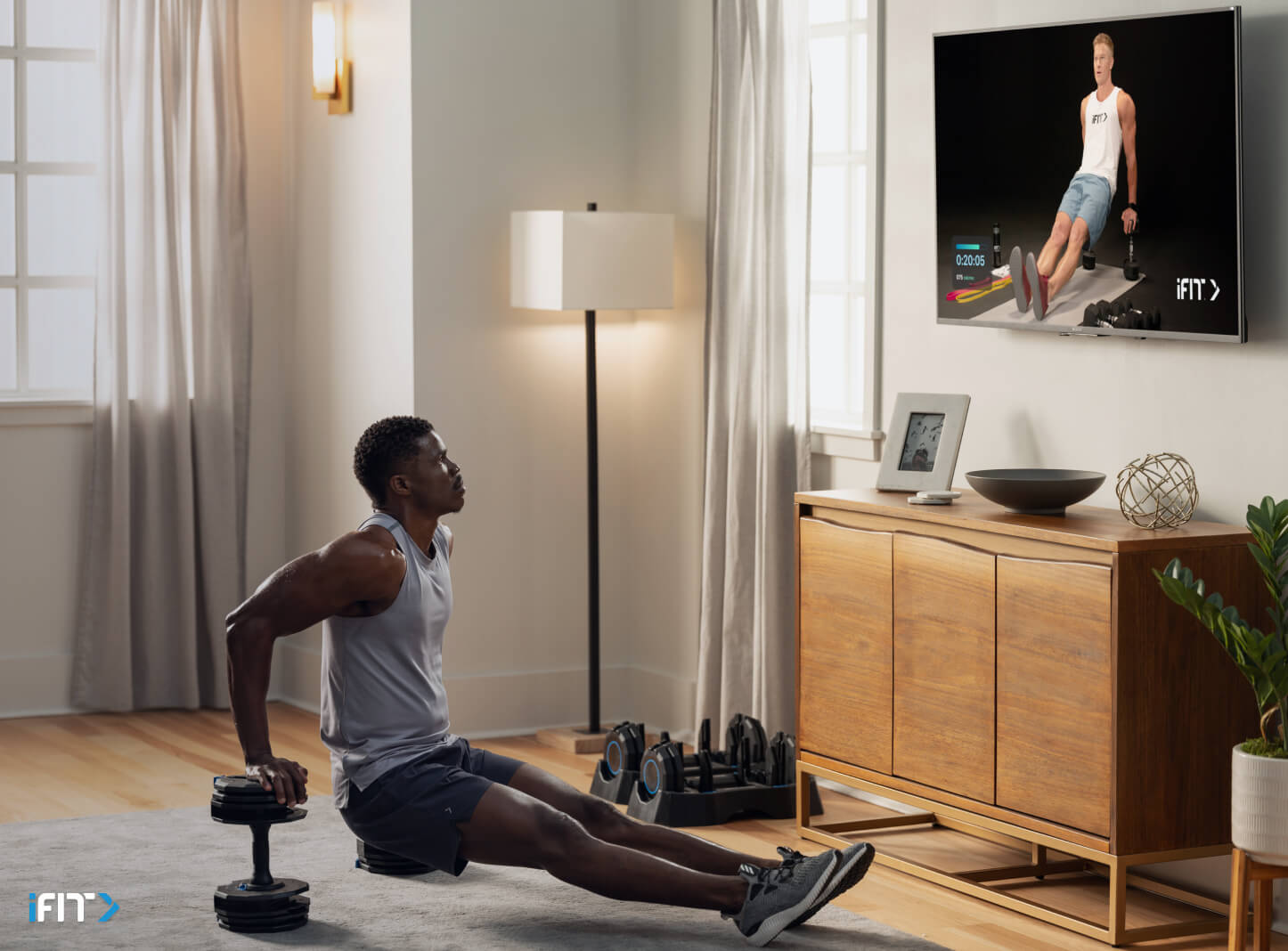Man works out with iFIT bodyweight exercises