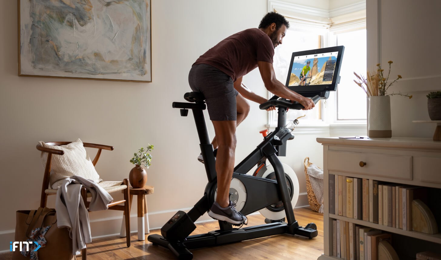 Man does an iFIT cardio workout