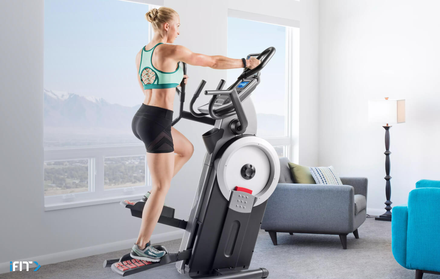 Woman completes an iFIT cardio workout