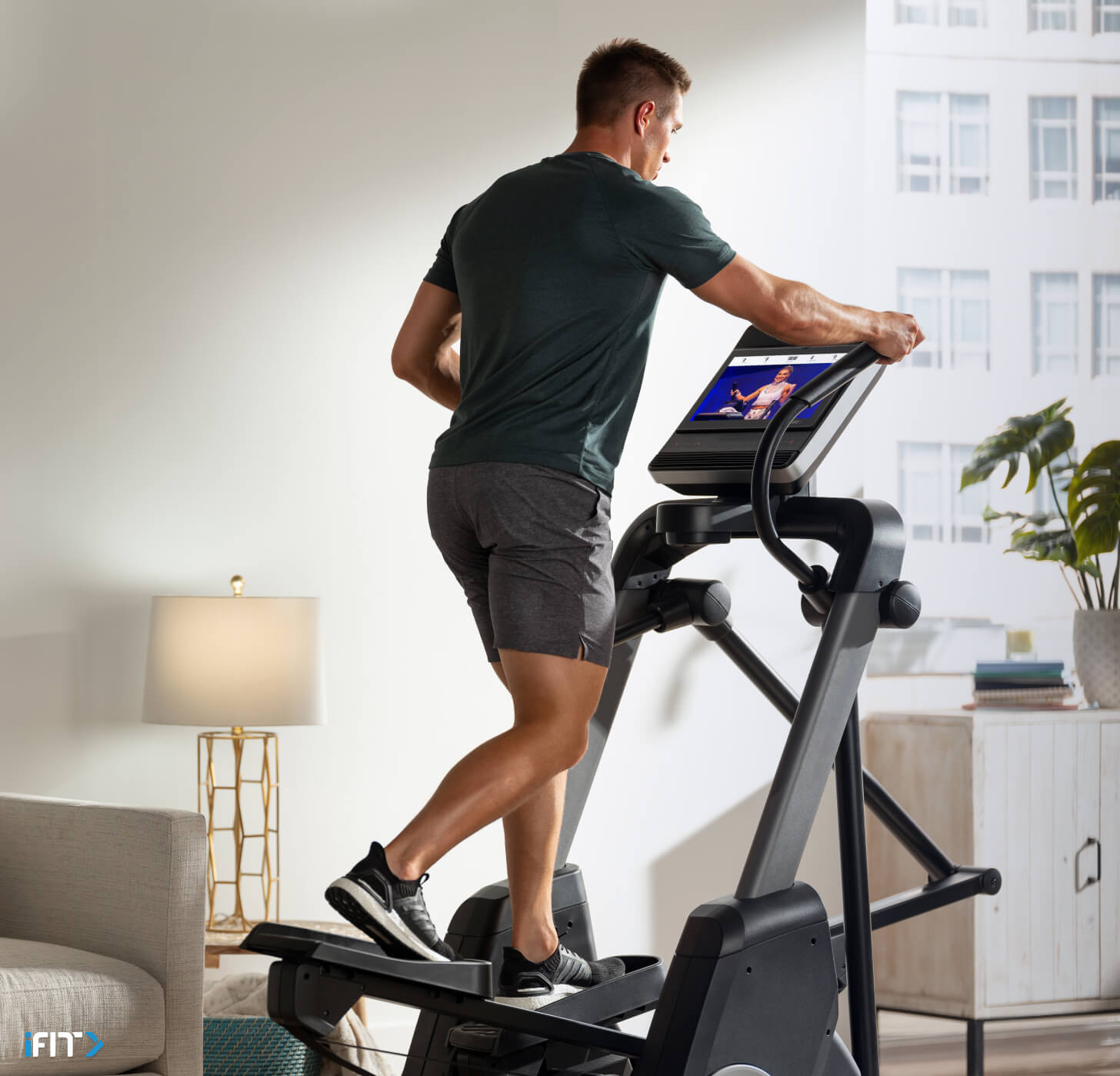 Man works out with an iFIT elliptical class