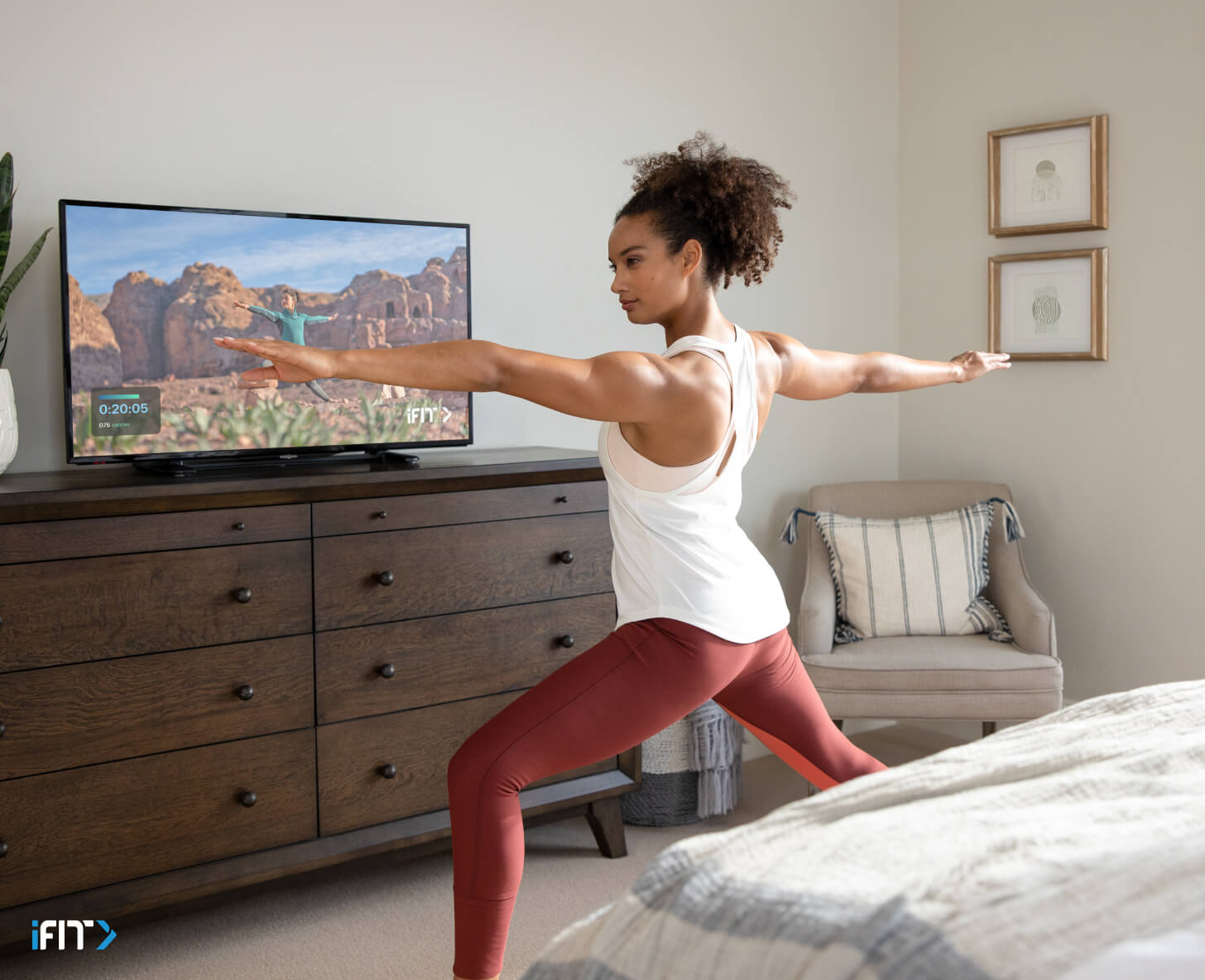 Woman works out with iFIT mindfulness classes