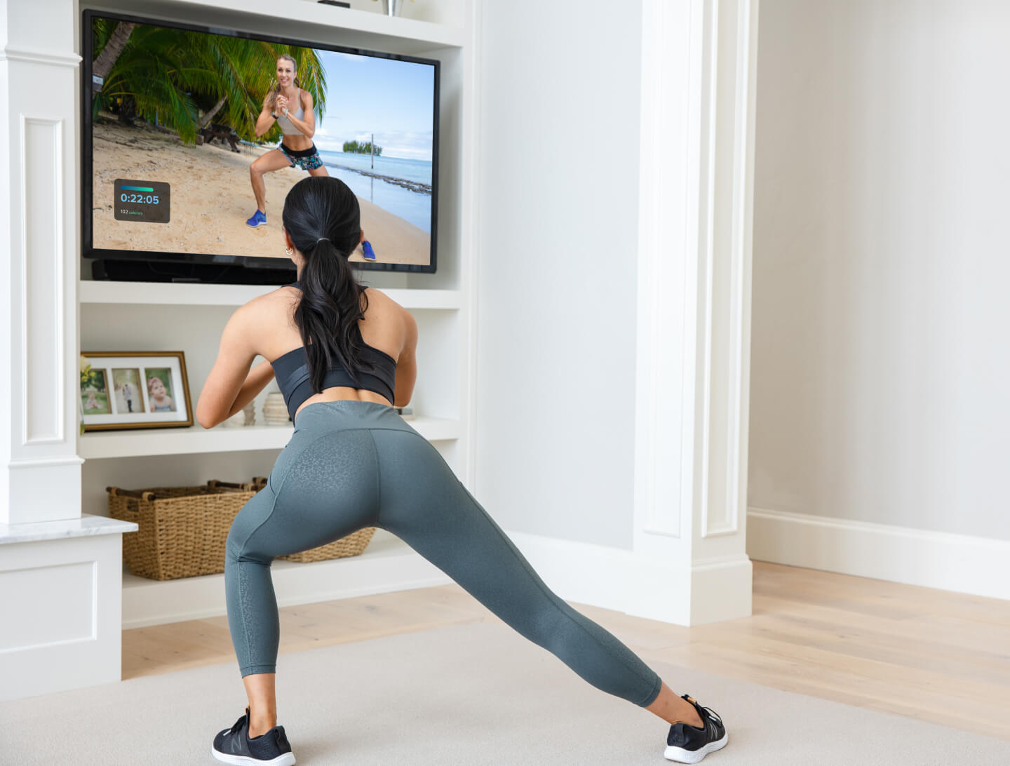 Woman works out to an iFIT TV app workout