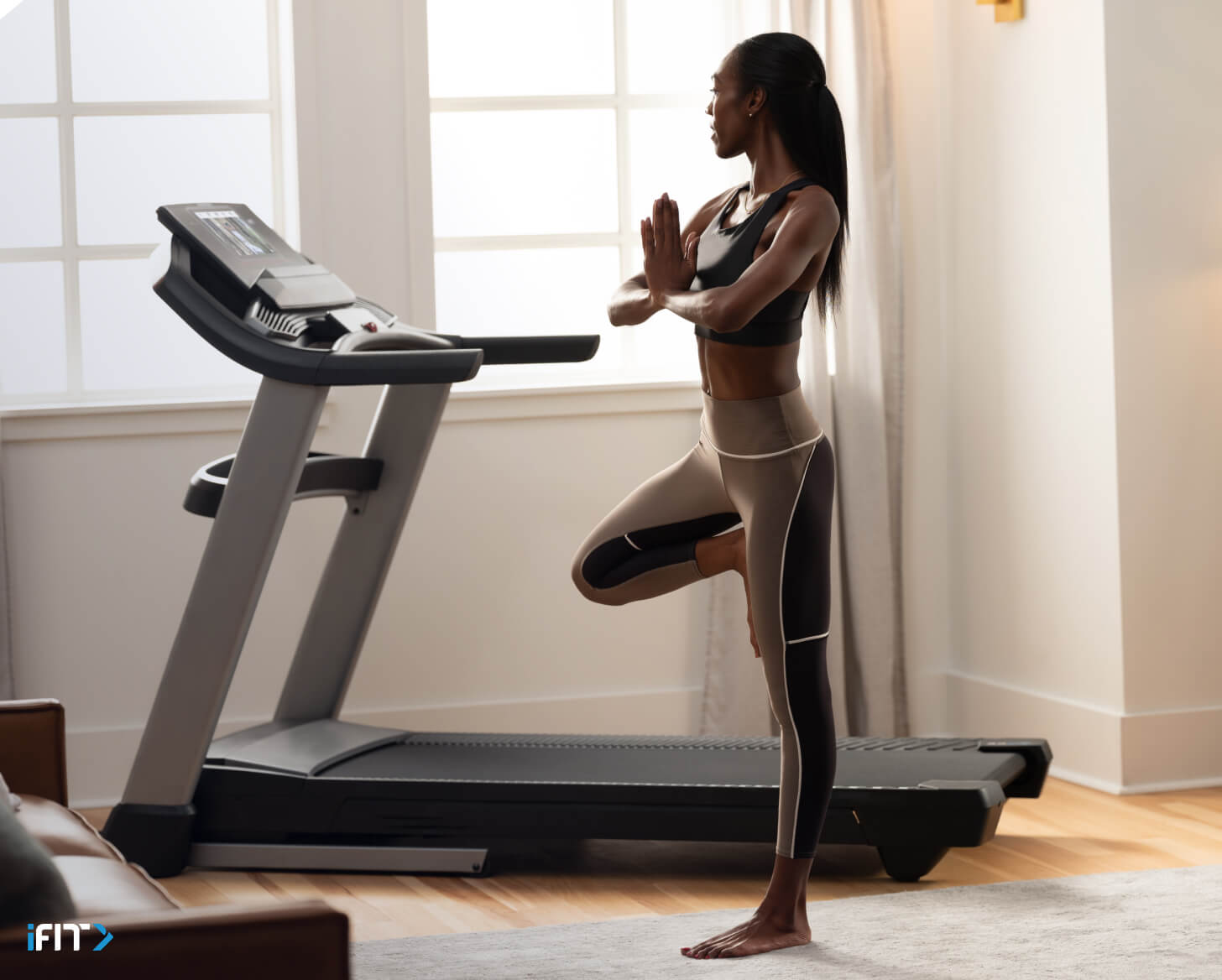 Woman works out to an iFIT meditation class