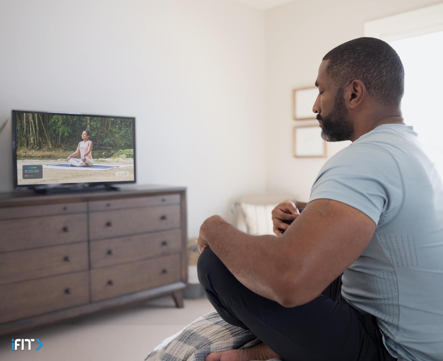 Man completes an iFIT mindfulness class