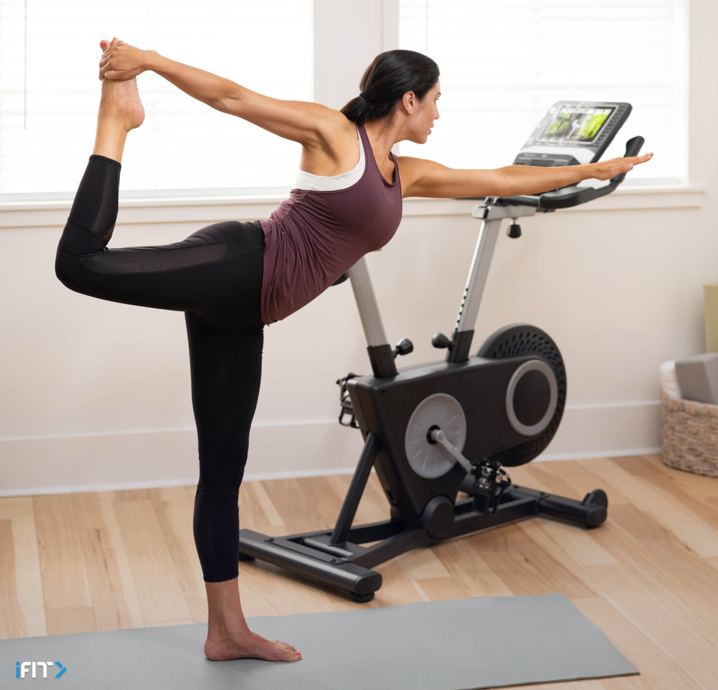 Woman works out with iFIT mindfulness exercises