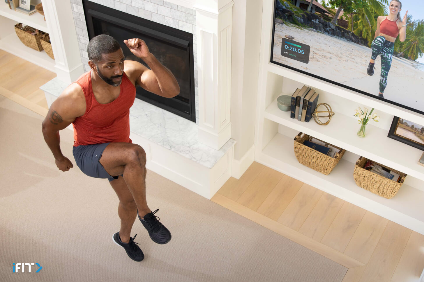 Man does iFIT full body workouts