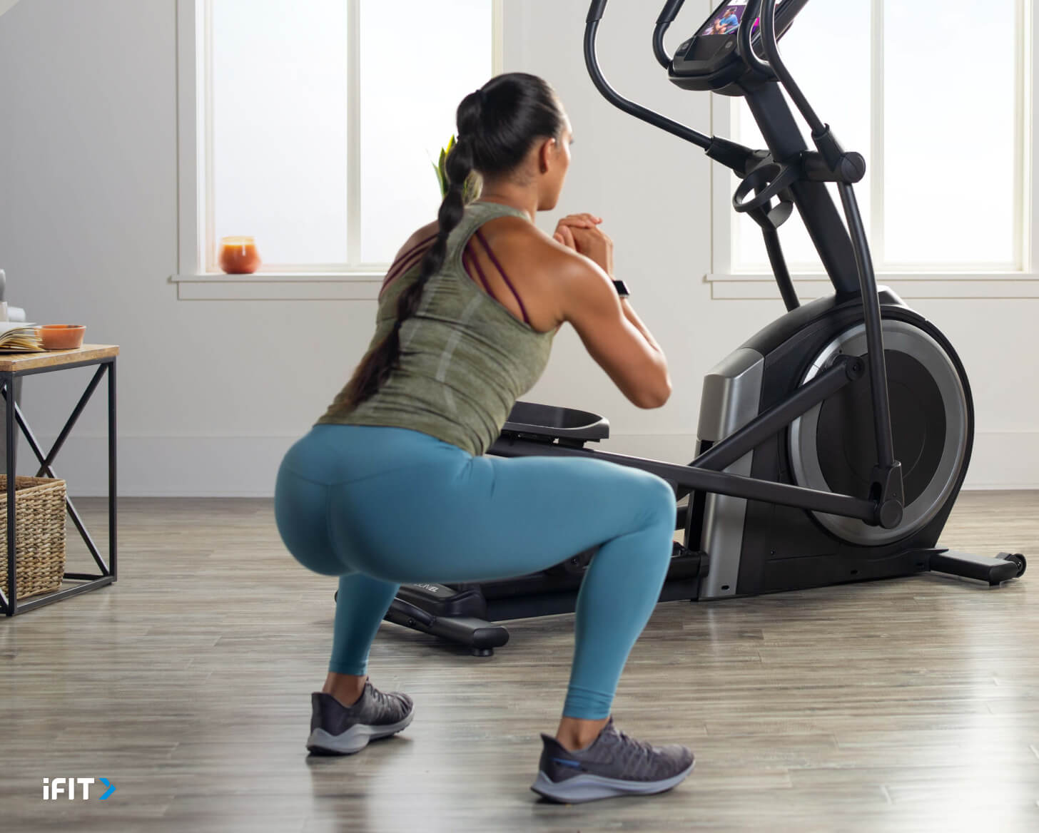 Woman works out with iFIT Tabata exercises