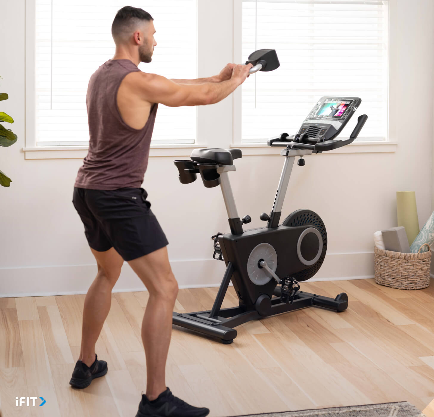 Man does an iFIT Tabata workout