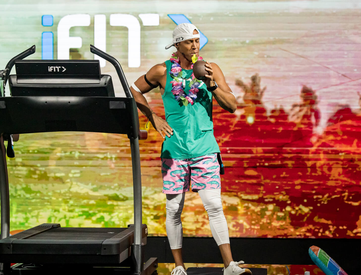iFIT Trainer Jonnie Gale coaches a running class